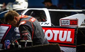 Larson works on his car