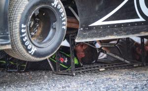 Strickler works underneath car